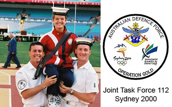 Leading Seaman Musician Matt Jessop and Able Seaman Musician Ken Ellis, from the Royal Australian Navy, hold US Paralympian Erin Popivich high at the closing ceremony of the Paralympic Games in Sydney 2000. Erin won gold and silver in swimming and carried her country's flag at the country's flag at the ceremony. The Operation GOLD patch worn by Australian Defence Force personnel who formed part of JTF 112 can be seen on LSMUS Jessop's sleeve. Design detail on the right.