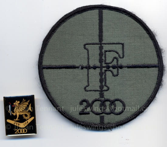 Olympic pin presented to members of the TAG of JTF 114 and patch worn by the TAG snipers around the holding area during their deployment in the Counter Terrorist Squadron during the Sydney Olympic Games.