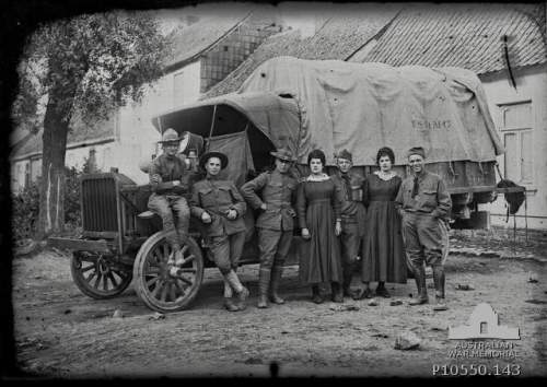 Group portrait of five unidentified American soldiers, with two local French civilian women, standing in front of a US Army Quarter Masters Corps truck. From the Thuillier collection of glass plate negatives. Taken by Louis and Antoinette Thuillier in Vignacourt, France during the period 1916 to 1918.Object TypeBlack & white - Glass original quarter-plate negative. Item IDP10550.143