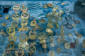 A selection of current Malaysian badges on display in the shop window of Uni Karisma Dagang shop at the Pertama Complex