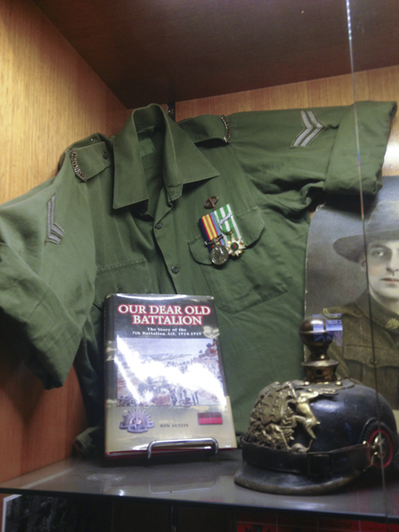 "Vietnam period jungle green shirt and WW1 german helmet in the """