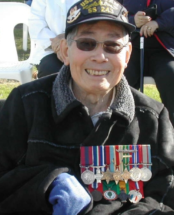 WW2 Australian Special Forces soldier, Jack Wong Sue DCM wearing his medals and the USN Submarine Combat Insignia award during the ANZAC Day commemorations.