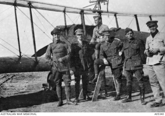 C flight No. 1 Squadron, Captain Richard (Dickie) Williams (later Air Marshal Sir Richard) the OC, is seen in the centre. From left the other officers are; Frank Hubert McNamara (the only AFC winner of the Victoria Cross (VC) in the first world war), L W Heathcote, S K Muir, E G Roberts and L J Wackett, in front of a Martinsyde aircraft. (Wing Commander E G Roberts collection). Photograph courtesy of the Australian War Memorial. Image No. A05340