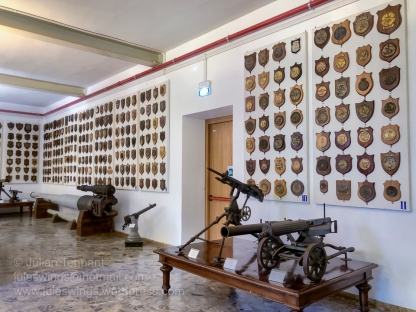 Various armaments and ships plaques on display at Venice's Museo Storica Navale