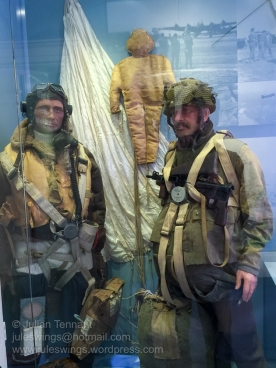 RAF aircrew and British Paratrooper with a 'dummy' para in the background. Photo: Julian Tennant