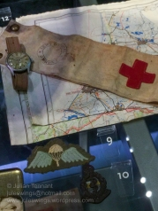 Watch, map, British medic's brassard, British para qualification wing and plastic economy issue Royal Army Medical Corps beret badge.