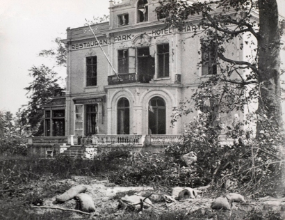 The Hotel Hartenstein as it appeared in 1945, shortly after Operation Market Garden. From a photograph album compiled by Frank Tomlinson, 74th Field Regiment, Royal Artillery of North West Europe from 1944-46. Held in the National Army Museum. Accession number: NAM. 2014-08-16-447