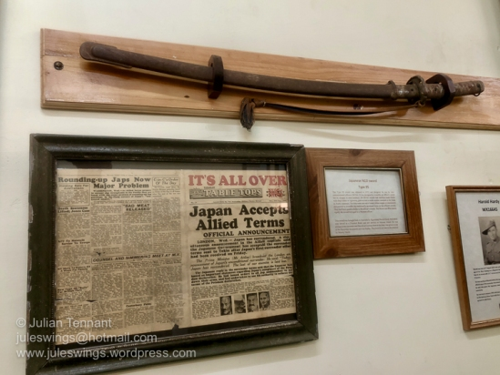 Newspaper and Type 95 Japanese NCO's sword brought back to Australia by Signalman Harold Hardy after the surrender of Japanese forces on Morotai Island. Photo: Julian Tennant.