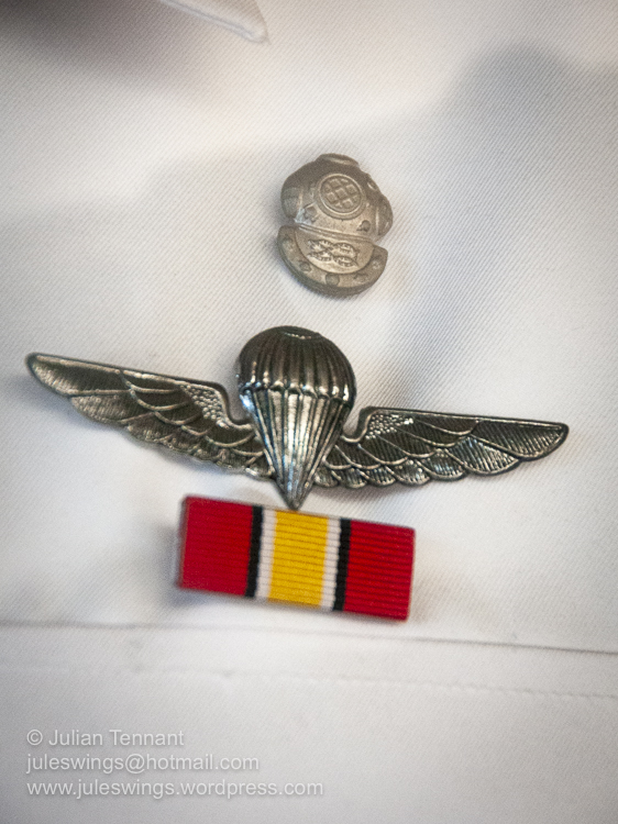 Royal Malaysian Navy Museum (Muzium Tentera Laut Diraja Malaysia). Sailor's uniform detail showing both the basic parachute and diving qualification badges. I am not sure which medal the ribbon represents.