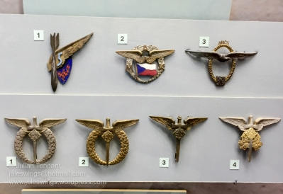 Inter-war period Czech Air Force insignia. Top Row: No.1. Unofficial badge of 5 Aviation Regiment in Brno. No.2. Moravian Aero Club badge. No.3. Republic of Czechoslovakia Aero Club badge. Bottom Row: No.1. Field Pilot qualification. No.2. Field Observer qualification. No.3. Field Air Gunner qualification. No.4. Field Air Observer of Arms.