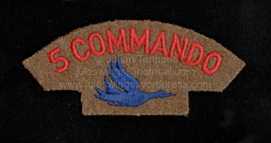 Original 5 Commando shoulder title from the estate of Bill Jacobs, a South African mercenary who served in the British Parachute Regiment prior to joining 5 Commando in the Congo in 1966-67. This is the 'heavy weight' wool variation of the insignia and is less common than the more extensively used light-weight variation which was produced on a tan polyester/cotton shirt type material. Collection: Julian Tennant
