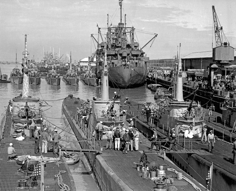 American Submarines at North Wharf, Fremantle, 1945. The ship in the background is submarine tender USS PELAIS, surrounded by her 'brood', which included the subs BONEFISH, RASHER, BOWFIN, BLUEFISH, NARWHAL, TINOSA, CREVALLE and COD. Photo: Family of RAN photographer, Saxon Fogarty