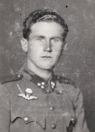 Studio portrait of (Corporal) Császár Vilmos wearing the distinctive silver bullion embroidered Hungarian parachutist wing. Collection: Julian Tennant