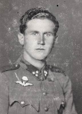 Studio portrait of (Corporal) Császár Vilmos wearing the distinctive silver bullion embroidered Hungarian parachutist wing. Collection: Julian Tennant