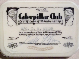 'Caterpillar Club membership card belonging to Warrant Officer David Milne who was taken prisoner after bailing out in Germany. Membership of the 'Caterpillar Club' is achieved by people who have saved their lives using parachutes manufactured by the IRVIN company. In addition to the membership card each individual is also presented with a gold pin of a caterpillar with ruby eyes, with their name engraved on the rear. The caterpillar being symbolic of the silk used in the manufacture of early parachutes. Photo: Julian Tennant