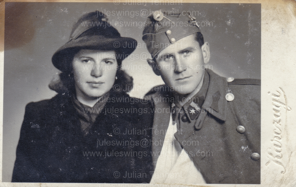 Studio portrait of (Sergeant) Császár Vilmos and female, possibly wife or sister? The photograph shows that his arm is in a sling, indicating a wound or injury so I am guessing that this photo was taken whilst on recovery leave. Note that Császár Vilmos is also wearing the bullion jump wing on the left side of his cap. Collection: Julian Tennant