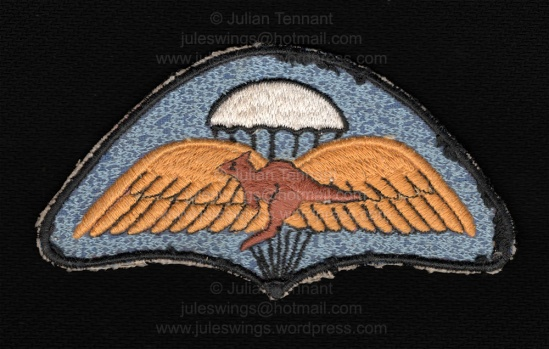 Unidentified Australian parachute patch. Because of the symbolism used here and also with the early Airborne Platoon crest, I wonder if this badge may have been used unofficially on sports wear, jumpsuits etc by members of the Airborne Platoon at some point from the late 50's through 1960's? I don't know the answer and any additional information is welcomed. Collection: Julian Tennant