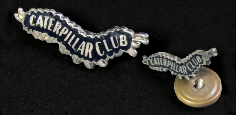 The two different sized Switlik Caterpillar Club badges made by the Metal Arts Co. during WW2.
