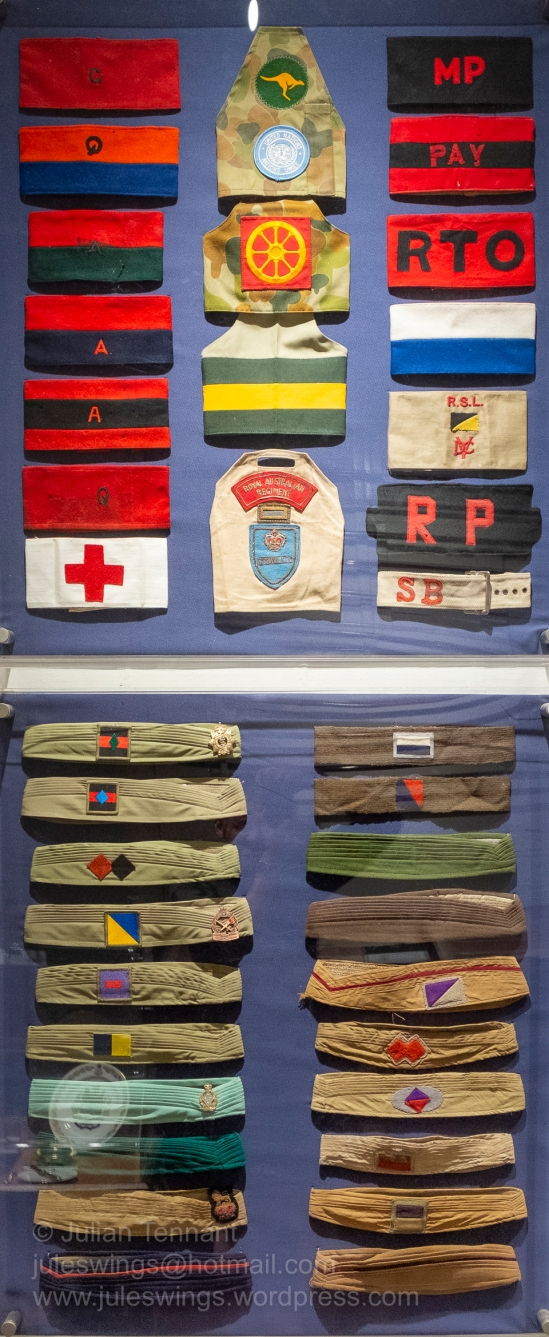 Australian Army brassards and slouch hat puggarees in the the Traditions Gallery. Photo: Julian Tennant