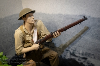 Detail showing an Australian Infantryman engaging descending German paratroopers in a diorama depicting the invasion of Crete, May 1941. Photo: Julian Tennant