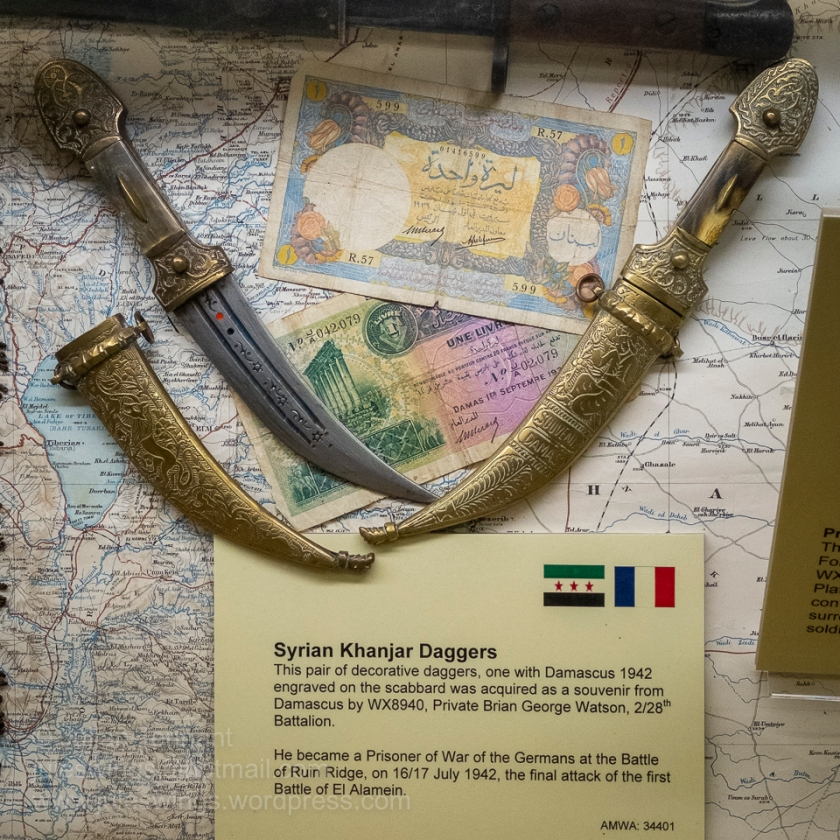 Syrian Khanjar Daggers. This pair of decorative daggers, one with Damascus 1942 engraved on the scabbard was acquired as a souvenir from Damascus by WX8940, Private Brian George Watson of the 2/28th Battalion. He became a POW of the Germans at the Battle of Ruin Ridge on 16/17 July 1942, which was the final attack of the first Battle of El Alamein. Photo: Julian Tennant