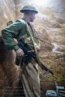 A soldier of the 2/16th Australian Infantry Battalion late 1942/early 1943. He is armed with a Thompson submachine gun and is dressed in the transitional uniform of khaki trousers and dyed shirt. By September 1943 when the battalion commenced operations in the Markham Valley, the Thompson had been replaced by the Owen submachine gun and jungle green trousers. Photo: Julian Tennant