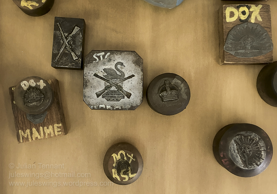 A selection of Dies used to manufacture badges. These were in a section currently being prepared for display. I suspect that the Dies are from the Sheridans company that is based in Perth and has made many military badges, particularly in the first half of the 20th century. Photo: Julian Tennant