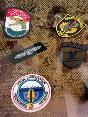Various police counter terrorist unit patches. Part of the Czech Police anti-terrorist URNA unit display at the Police Museum, Prague. Photo: Julian Tennant
