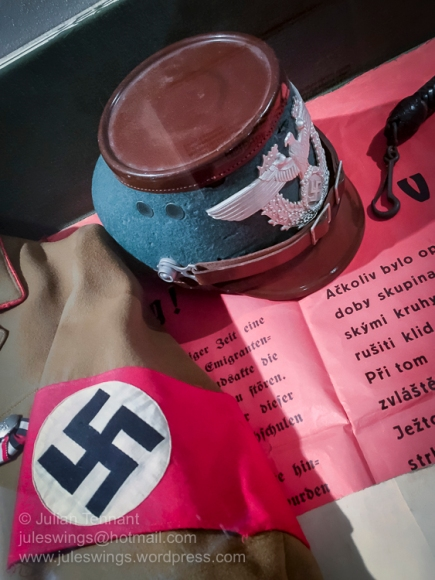 German occupation period Police hemet and armband. Photo: Julian Tennant