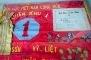 Flag plus South Vietnamese medals and medal award certificate on display at the Ho Chi Minh Campaign Museum. Photo: Julian Tennant