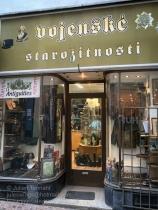Entrance to Vojenské starožitnosti / Military antiques shop, Charvátova 58/11, 110 00 Nové Město, Prague
