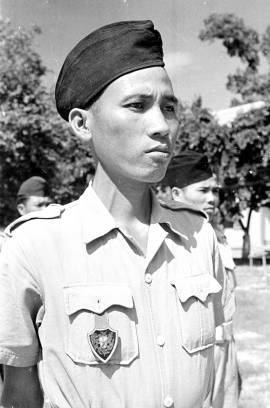 1950 portrait of a Cao Đài soldier wearing the distinctive pocket crest badge. This is the locally made variation. Photo: Harrison Forman LIFE Magazine 1950.