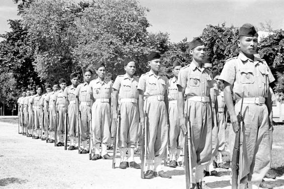 Cao Đài troops on parade at Tây Ninh in 1950. Photo: Harrison Forman