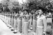 Cao Đài troops present arms during a parade at Tây Ninh in 1950. Photo: Harrison Forman LIFE Magazine