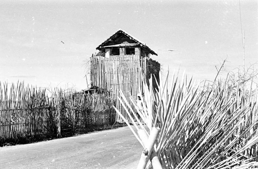 1950-view-of-watchtower-behind-bamboo-barricade-in-ty-ninh_12469862555_o