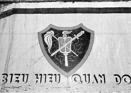 Crest of the Cao Đài military units painted onto the wall of their military college at Tây Ninh. Photo: Harrison Forman LIFE Magazine 1950