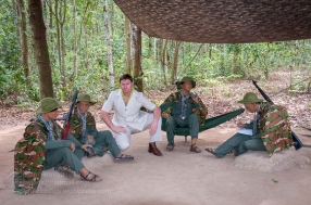 Australian visitor 'Safaribob' poses with some well dressed Viet Cong cadres on display at the Cu Chi Tunnels tourist park. Photo: Julian Tennant