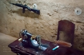 M2 carbine and sewing machine in one of the workshop displays at the Cu Chi Tunnel theme park. Photo: Julian Tennant