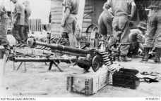 Weapons captured by the Australians during Operation CRIMP. The machine gun in the foreground is a Soviet DShk 12.7mm Heavy Machine Gun. Photograph: Alexander 'Sandy' MacGregor. Australian War Memorial Collection Accession Number: P01595.071