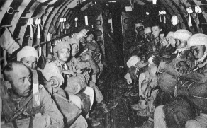 Paratroopers of 1 BPL prior to a training jump. The French officer at the front left is Captain Lucas who served in the Battalion from April 1952 until 22 April 1953 when he was captured by the Viet Minh. He had led the battalion during the airborne reinforcement of Sam Neau (Operation Noel) but was captured in the vicinity of Ban Hua Muong, during the retreat after Viet Minh forces overran the garrison. He was reported as having died in captivity on 1 December 1953.