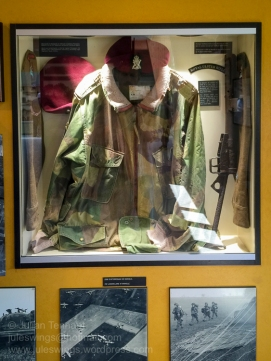 Objects relating to the Royal Ulster Rifles. The Dennison smock was worn on D-Day and during the Battle of Normandy by Captain Bob Sheridan, Adjutant of the 1st Battalion Royal Ulster Rifles. Photo: Julian Tennant