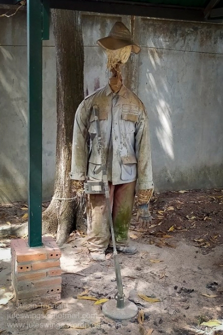 Tattered mine-clearance team uniform and equipment on display at the War Museum Cambodia. Most of the displays are left exposed to the elements and are unlikely to last long in the tropical Cambodian climate. Photo: Julian Tennant