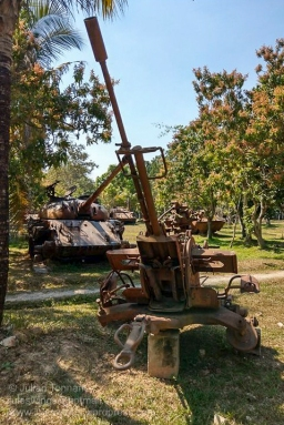 Anti-aircraft gun and rusted armoured vehicles on display at the War Museum Cambodia, Siem Reap. Photo: Julian Tennant