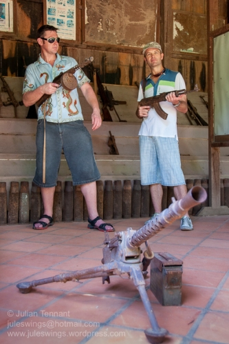 Tourists playing with some of the rusted weapons on display the War Museum Cambodia. Photo: Julian Tennant