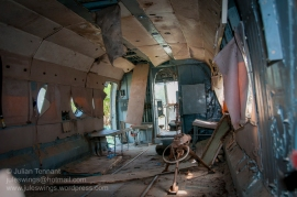The wrecked and dilapidated interior of the Mil Mi-8 transport helicopter at the War Museum Cambodia. Until recently very little effort had been made to protect or conserve the exhibits fueling speculation that despite the museum's stated aim of preserving the history and memory of Cambodia's three decades of war, it was little more than a cash-cow for government officials seeking to extract money from visiting tourists. Photo: Julian Tennant