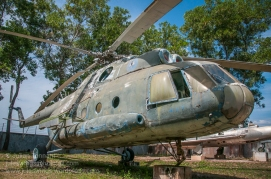 An old deteriorating Mil Mi-8 twin turbine transport helicopter on display at the War Museum Cambodia in Siem Reap. Photo: Julian Tennant