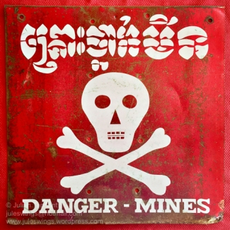 Older 1993 era metal Cambodian Minefield Warning sign. Collection: Julian Tennant
