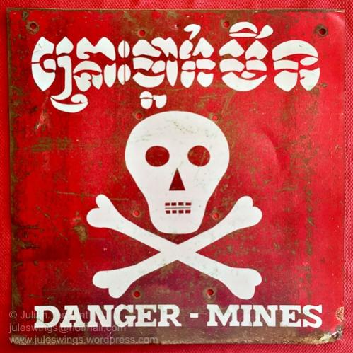 Older 1993 era metal Cambodian Minefield Warning sign. Collection: Julian Tennant