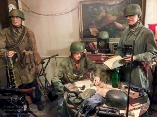 Dead Man's Corner Museum exhibit displaying Major von der Heydte, commanding officer of Fallschirmjäger Regiment 6 in the room that he used as his command post during the fighting around Saint-Côme-du-Mont on the 6th of June 1944. Photo: Julian Tennant