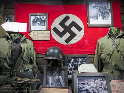 American uniforms and captured flag on display at Dead Man's Corner Museum, Normandy, France. Photo: Julian Tennant